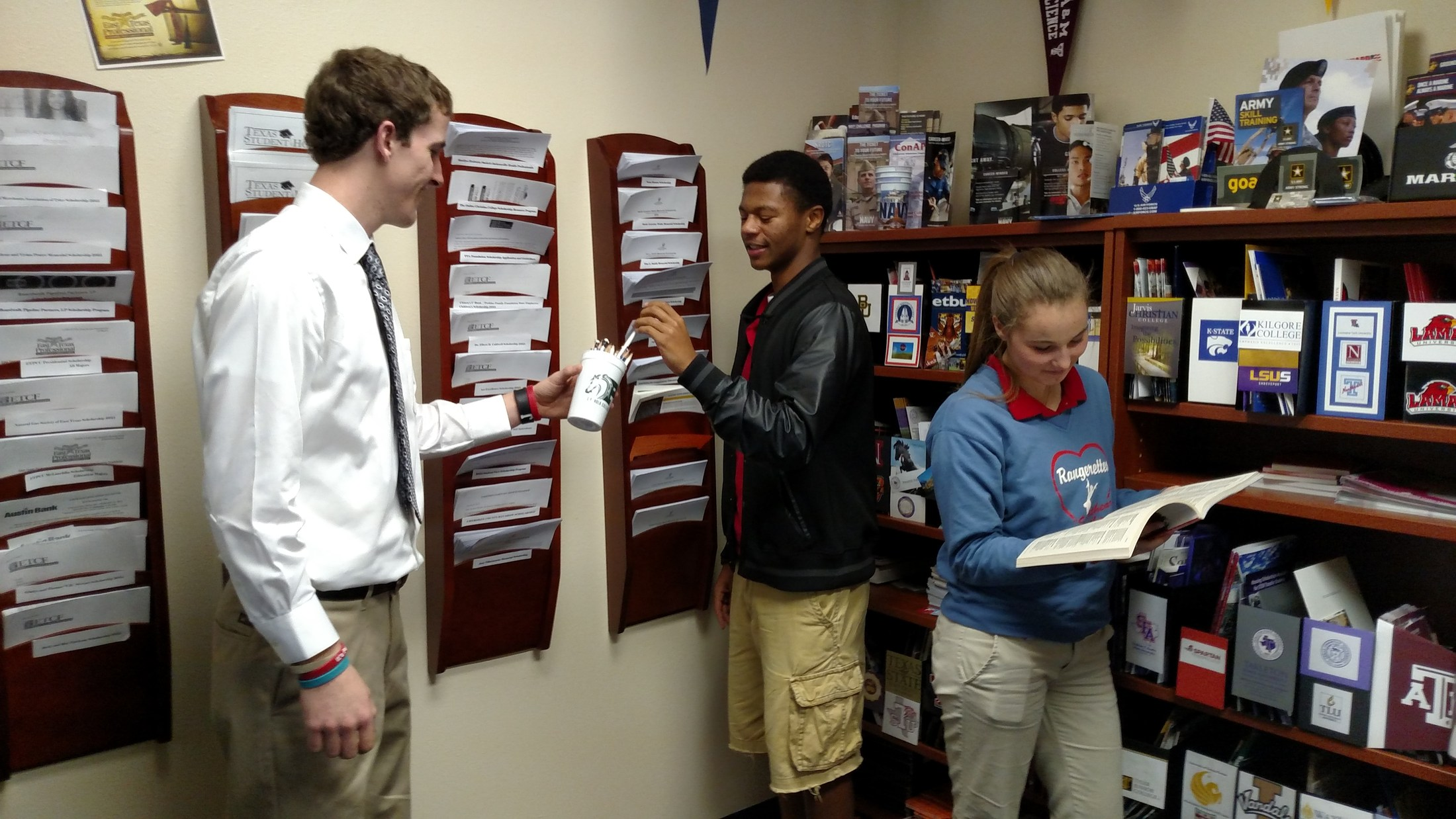 Students browse scholarships in the Go Center