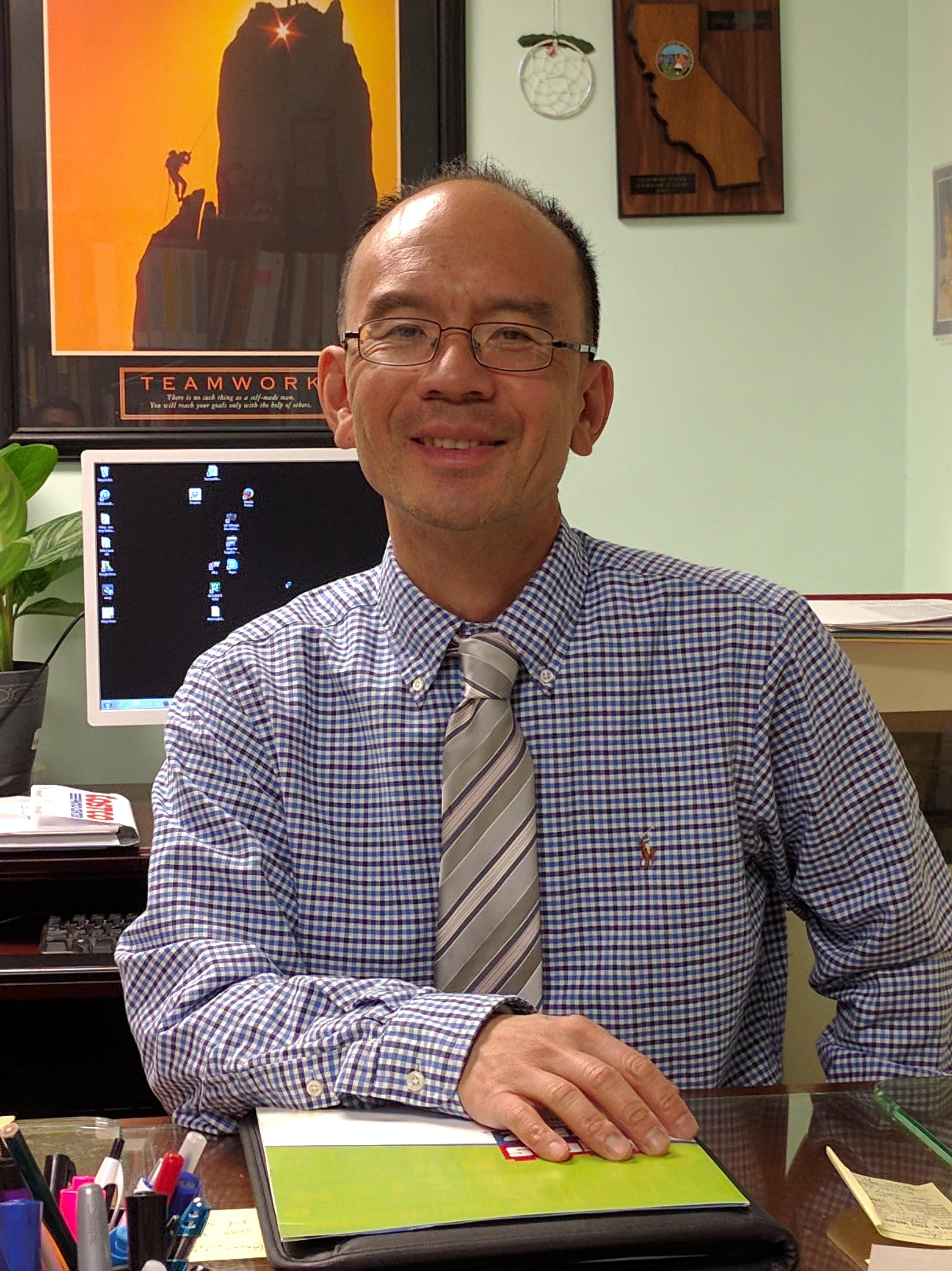 Mr. Hing Chow Principal