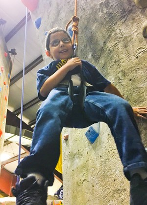 Young camper thrilled to have had a successful climb.