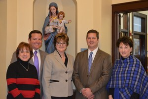 OLSH leadership poses with representatives from Northwest Bank who made a donation to OLSH through the OSTC program.