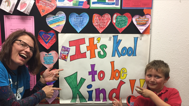 Dr. Winn and student pointing to Kindness Matters