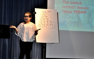Walnut Elementary fifth-grader Genesis Esparza explains how students would prefer to build projects instead of doing worksheets during a presentation on Oct. 30.