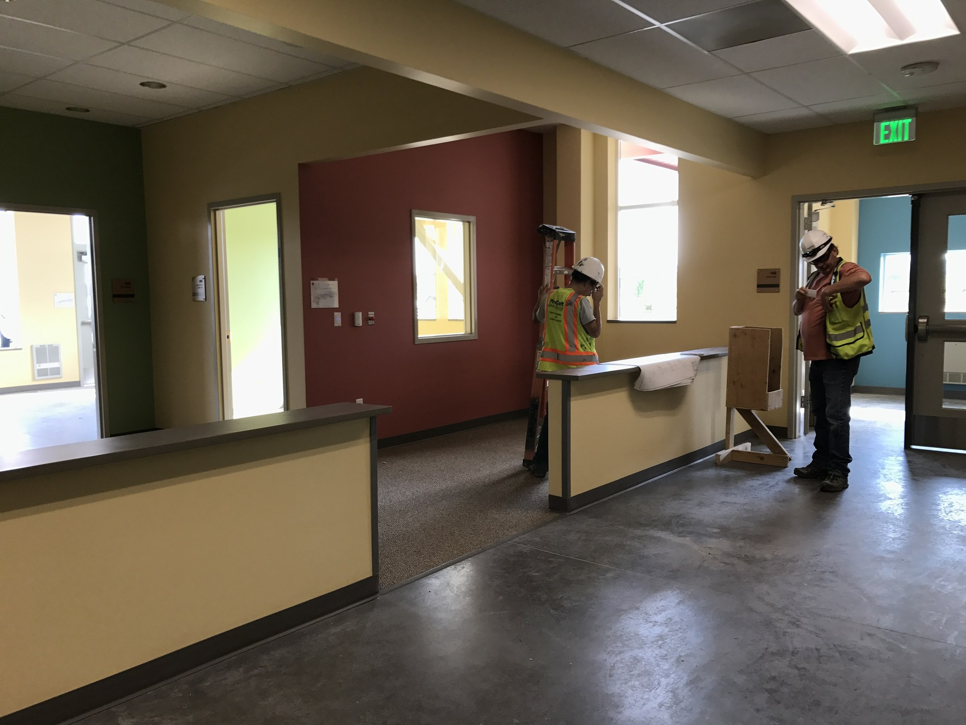 KindiePrep front office with construction worker standing at the desk