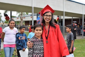 Sierra Vista senior Ashley Perez is welcomed to Tracy Elementary with student-made congratulations posters and hugs. The inaugural Senior Walk held May 26 gave graduating seniors the opportunity to celebrate with elementary students and past teachers.
