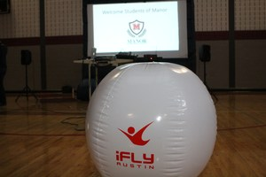 iflight inflatable ball in front of prjection screen.