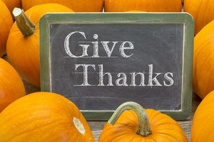 Image of pumpkins and Give Thanks sign