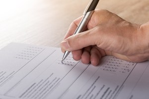 Image of a person taking a written survey