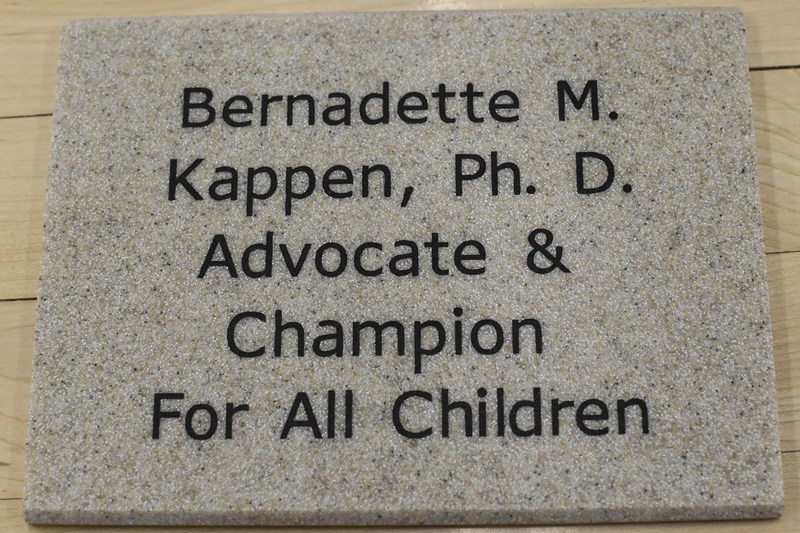 Dr. Kappen to recieve prestigious advocacy award is congratuated at school assembly.