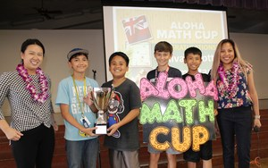 Student council receiving the Imagine Math Aloha Math Cup from Imagine representatives.