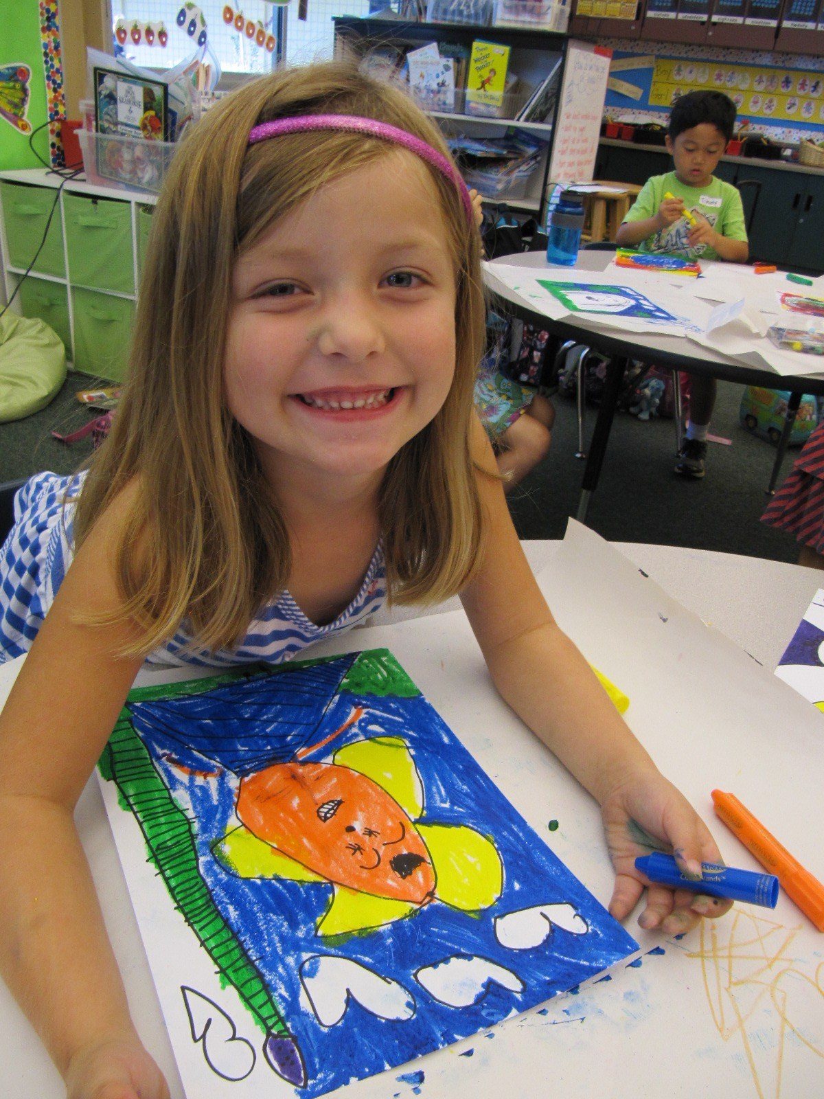A girl creating a self-portrait with makers.