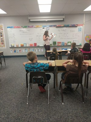 Lauren Egbert reading to students.