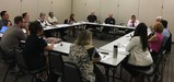Members of local community organizations discuss their mentoring and youth support programs to enhance collaboration and communication.