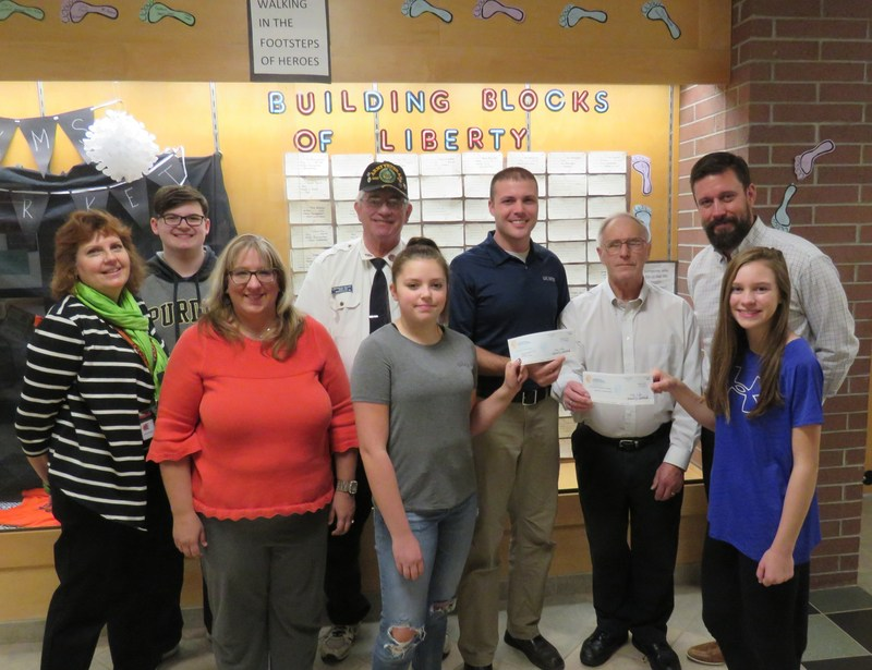 Eighth-graders make donations to help veterans.