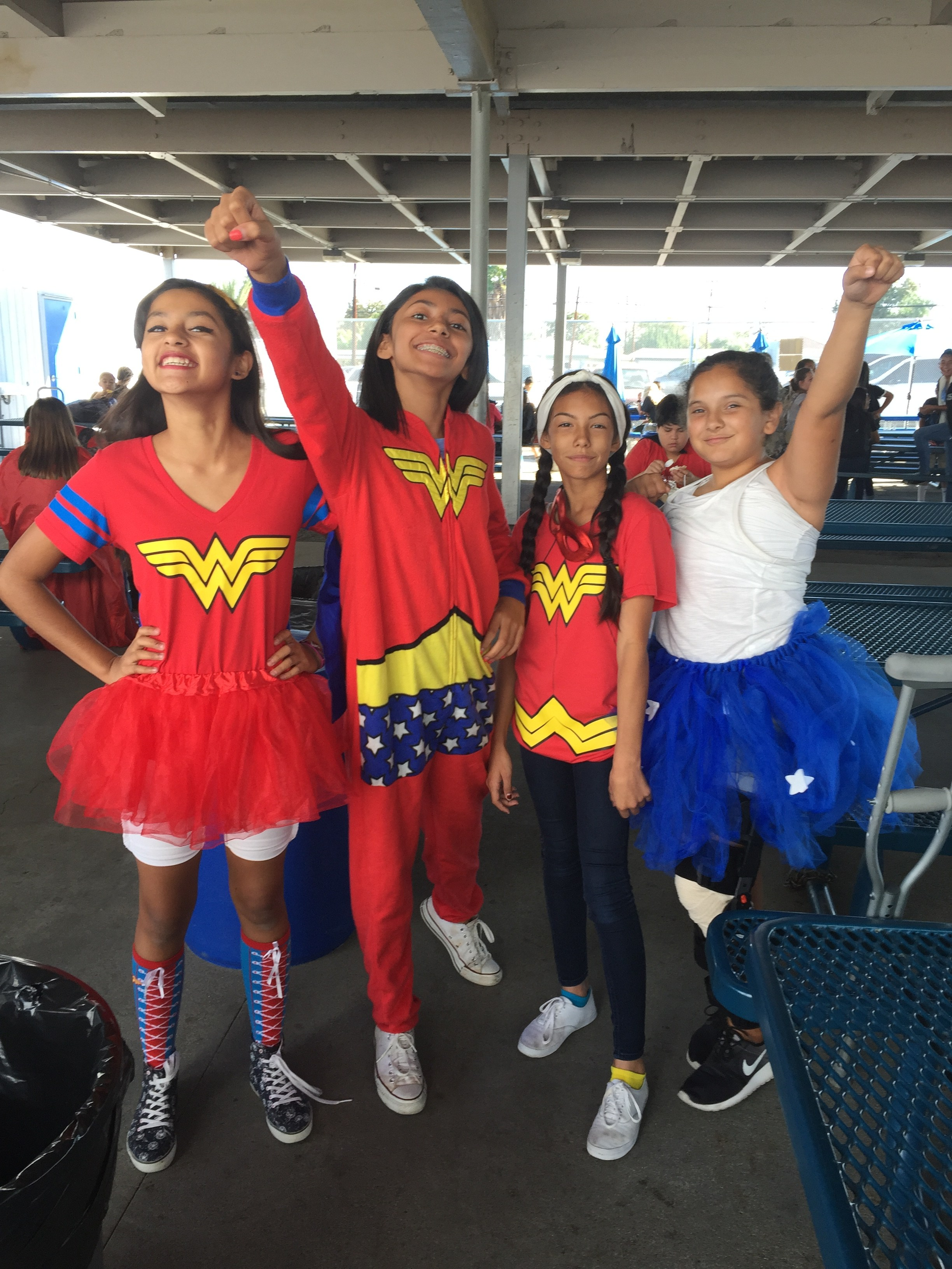A group of students dressed up as superheros and posing