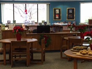 The library's circulation desk has been moved to a more central location in the room.
