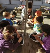 Children studying soil