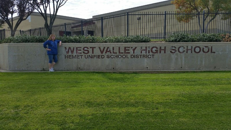 Joyce Stange in front of a West Valley sign.