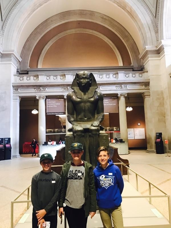 3 boys in Natural History Museum
