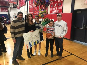 Kenna Squier 1,000th point family picture