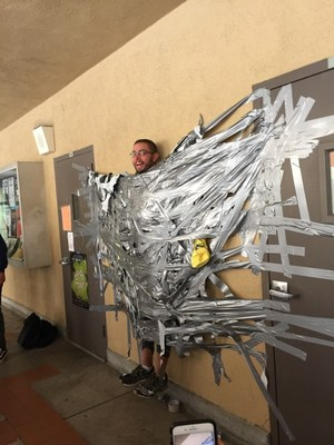 Students duct tape teacher as part of Wish Week fundraising
