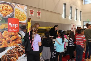 Students visiting food booths
