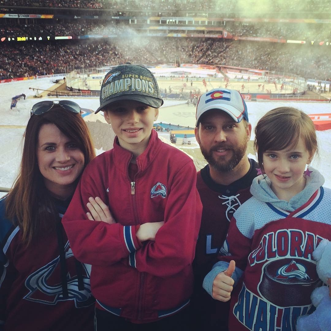 Mr. Wolf's family at a Colorado Avalanche game.