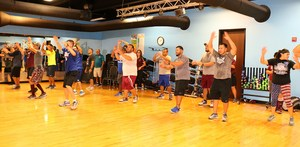 Coaches practice Zumba style moves