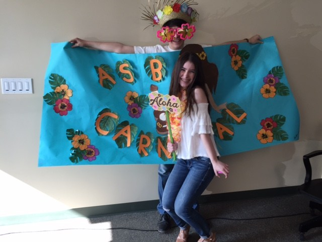 Photo of students holding up a banner for the ASB Carnival in 2016