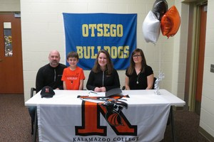 Kassidy Wesaw signs letter of intent with her parents and brother.