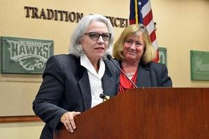 Ginger Geftakys speaks at a Board meeting