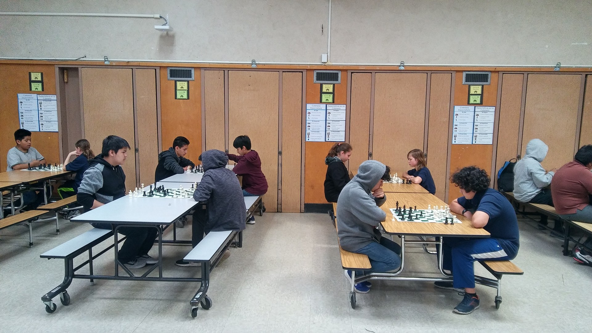 Middle School students playing chess in the second round of the tournament.