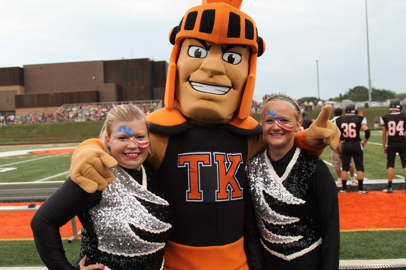 The new TKHS Trojan mascot poses with two members of the flag corp as the high school gets ready for homecoming.