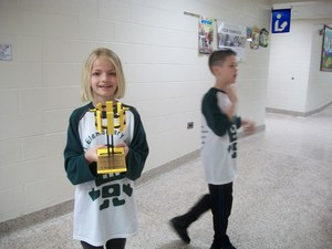 Robotics students parade through hallways.
