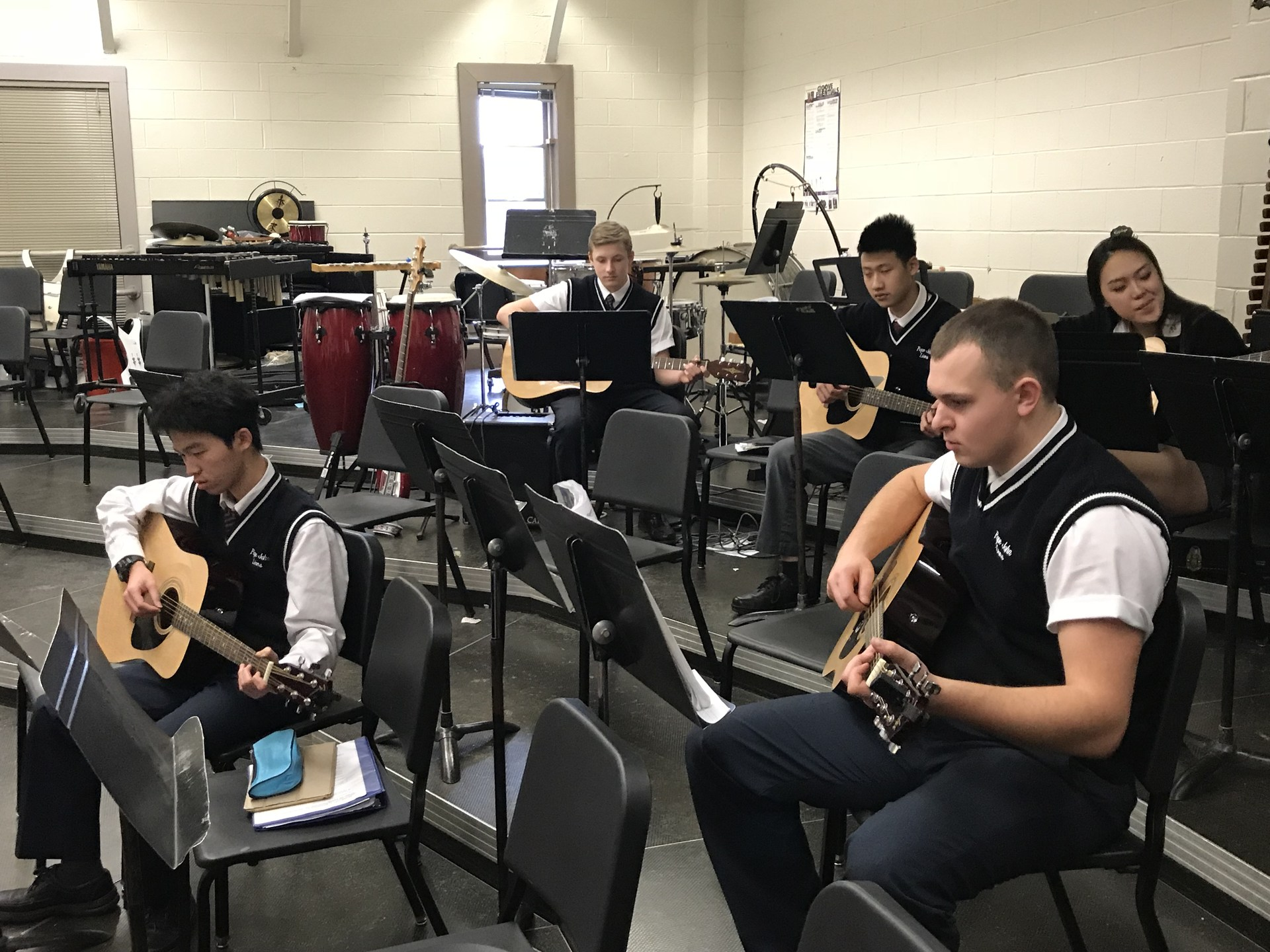 Students playing guitar in class