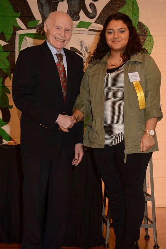 Herb Kohl and student accepting the award