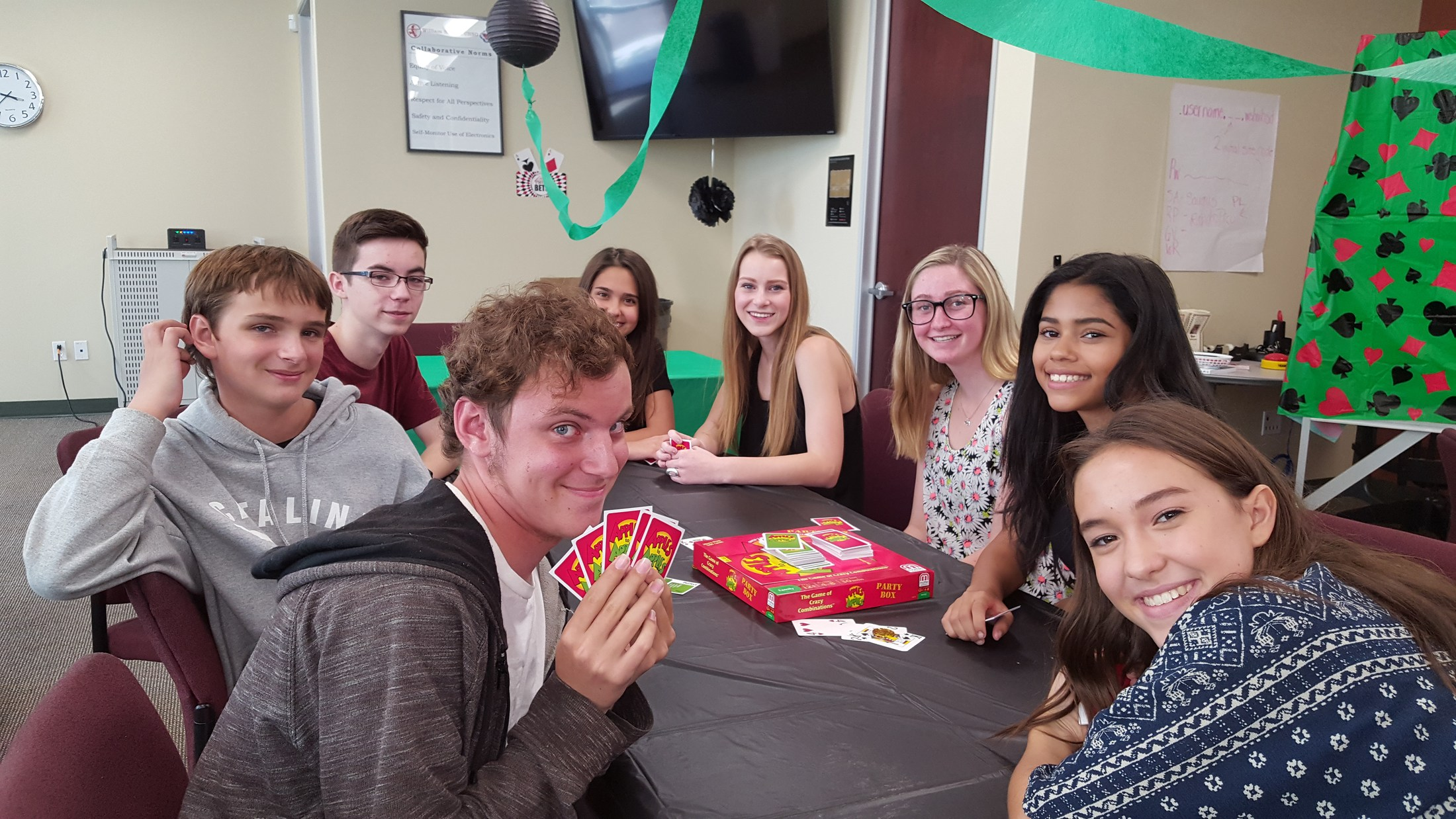 Photo of students playing card games at game night