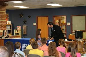 Student receiving scholarship award to Camp Invention.jpg