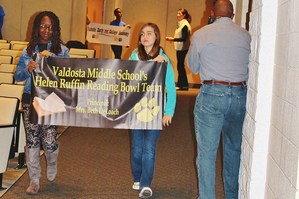 students carrying vms banner