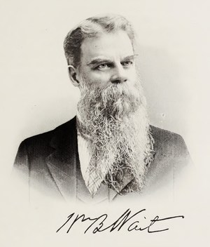Photo of Wait with a long beard and mustache, his signature is below his image