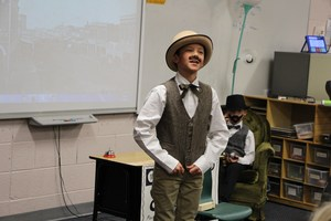 A student presents on Colorado life during the 1800s.