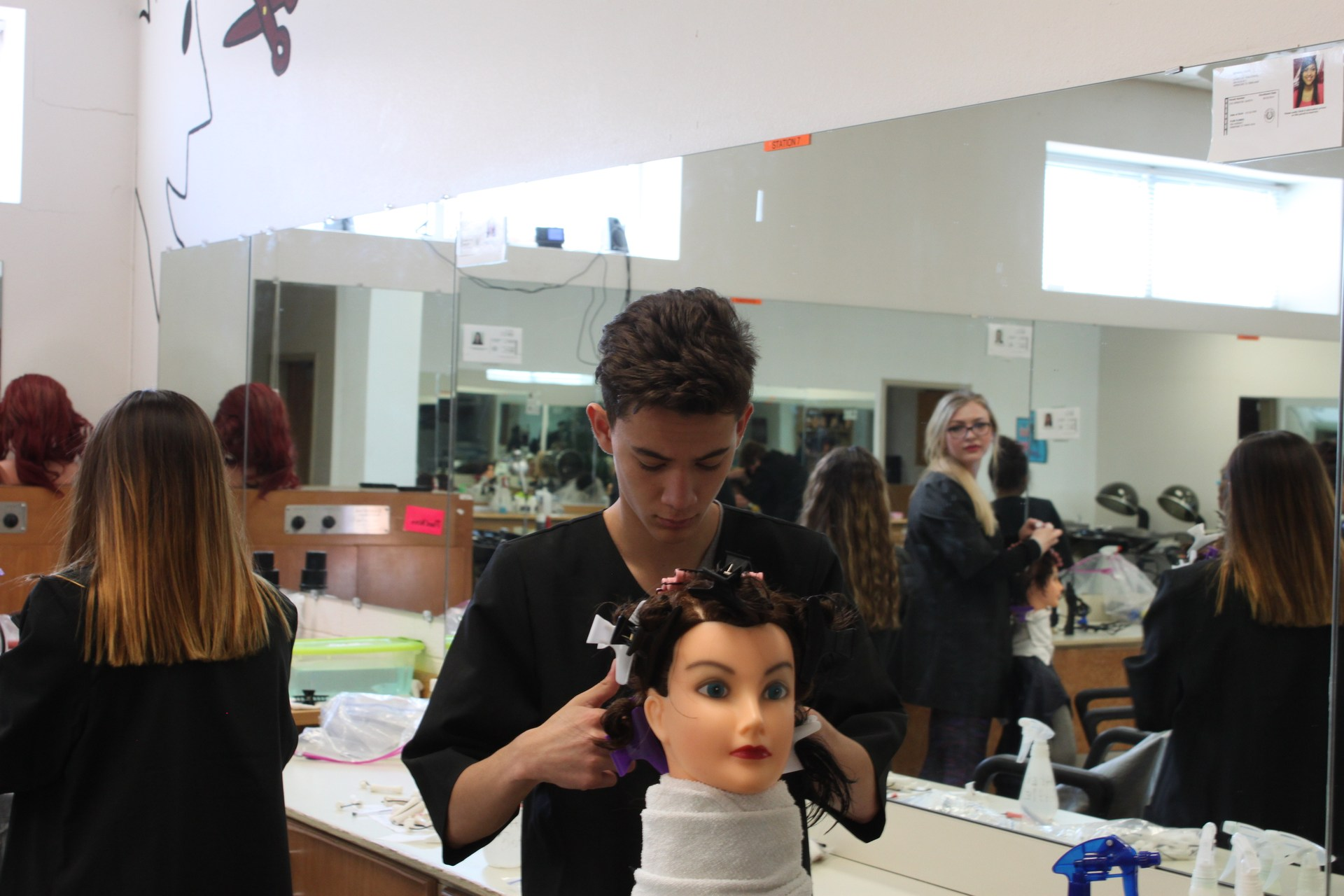 Student learning hairstyling