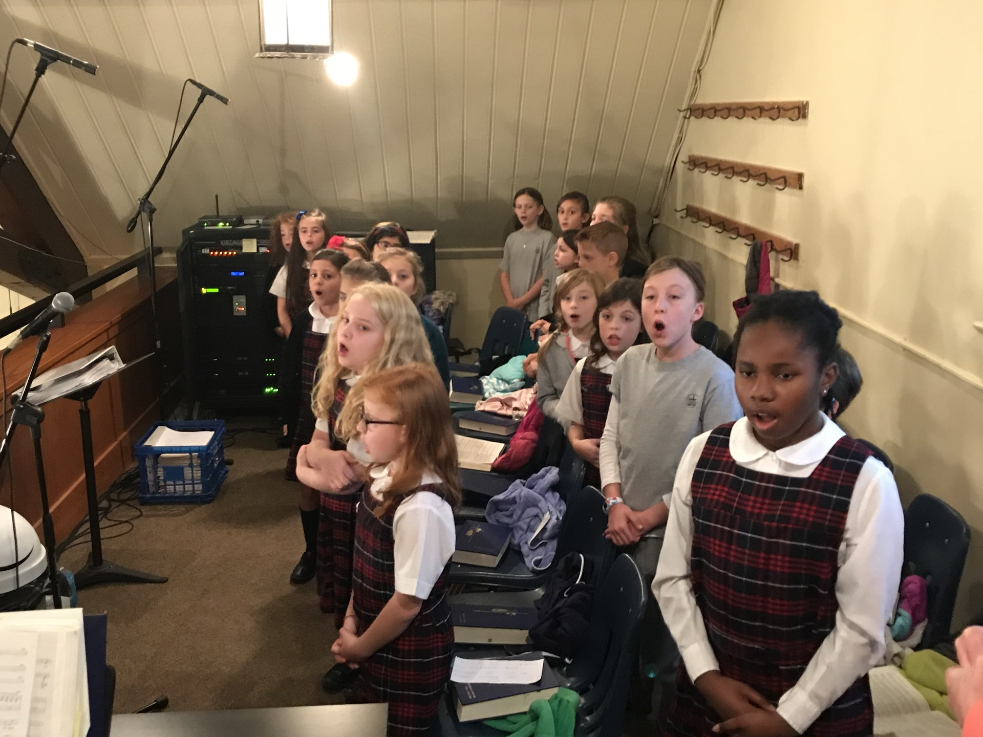 Students sing in choir at church