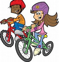 BOY AND GIRL RIDING BIKES WITH HELMETS