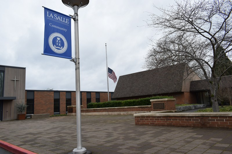 Lowered flag in front of school.