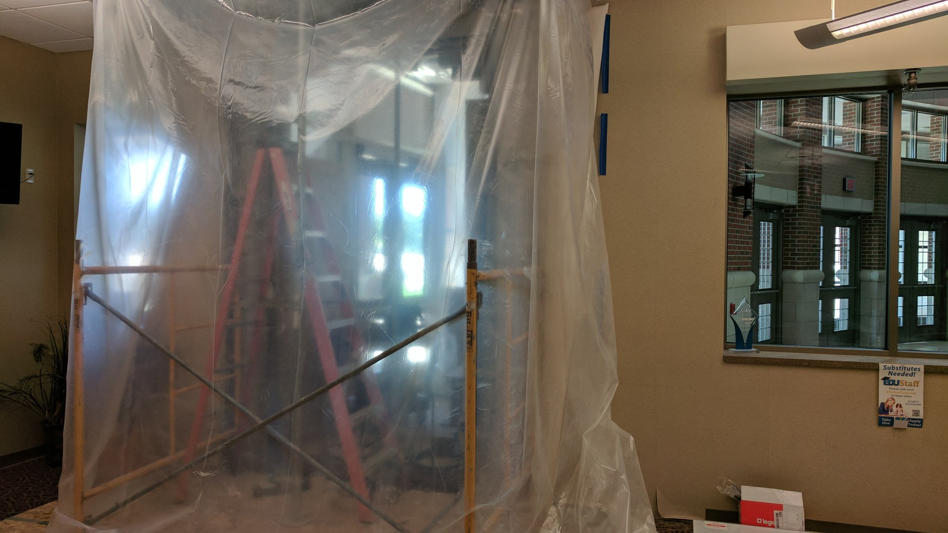 A new doorway is cut into the high school office for visitors.