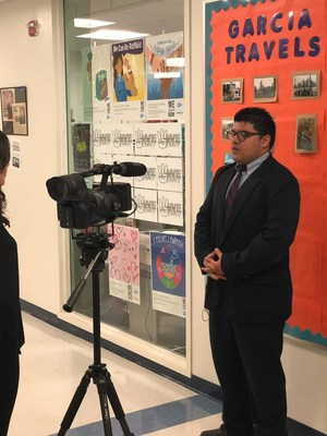 Student being interviewed by TV reporter