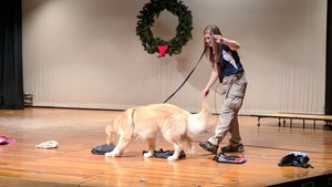 Zeus the dog searches backpacks and purses during a demonstration at the assembly at OMS.
