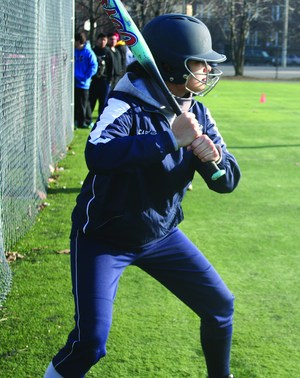 Rickover cadet waiting her turn to bat