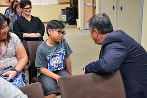 PYLUSD Superintendent Dr. Greg Plutko talks to Wagner Elementary School fifth grader Jacob Adarlo before the Board meeting