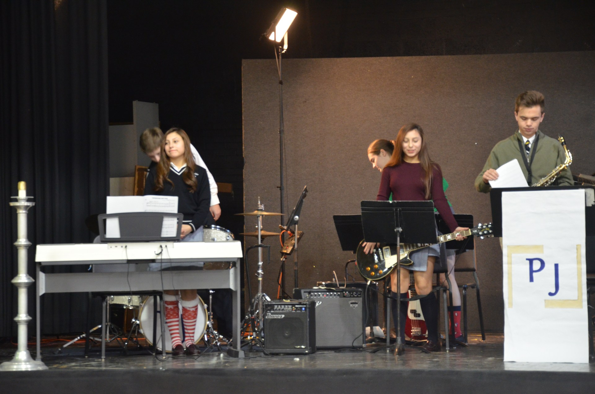 Student band playing in mass again